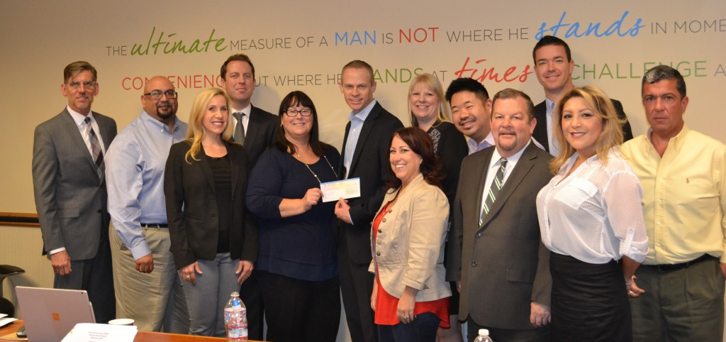 MEMBERS OF CAA GREATER INLAND EMPIRE PRESENT A CHECK FOR $10,000 TO INLAND EMPIRE UNITED WAY. PHOTO BY MATT BUCK